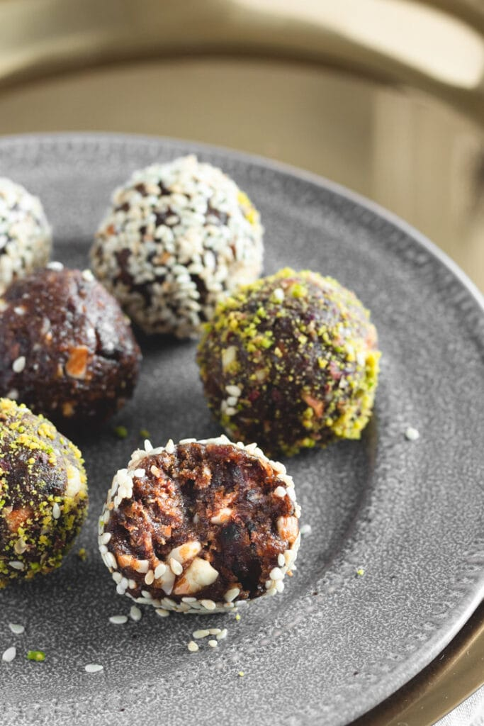 Date Truffles on a platter on top of a gold tray