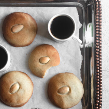 Cardamom shortbread served on a tray with a cup of coffee