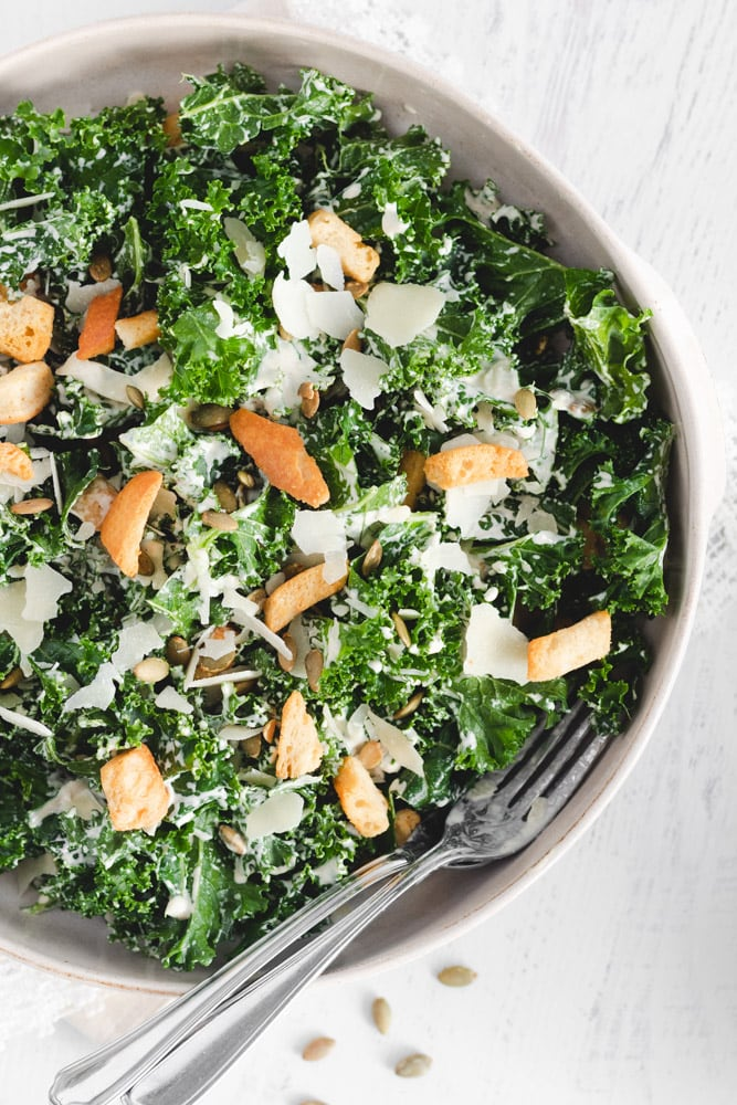 Kale Tahini Salad served in a large serving dish with Tahini Salad dressing