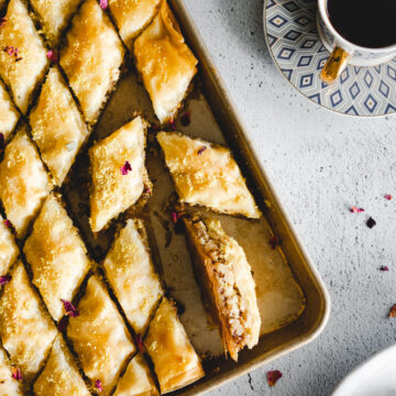Baklawa (Baklava) on a tray cut into diamond shapes