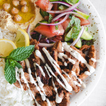Shawarma plate with hummus, rice, chicken and salad