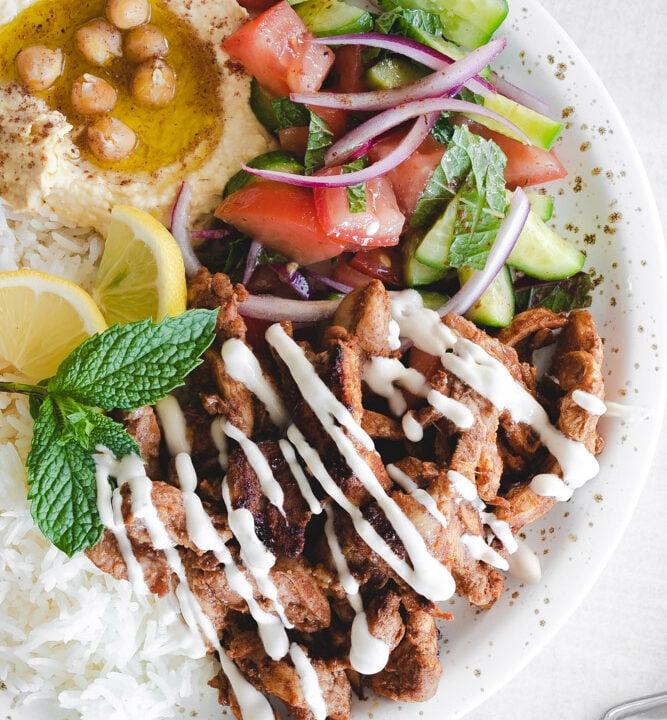 Shawarma plate with hummus, rice, chicken and salad