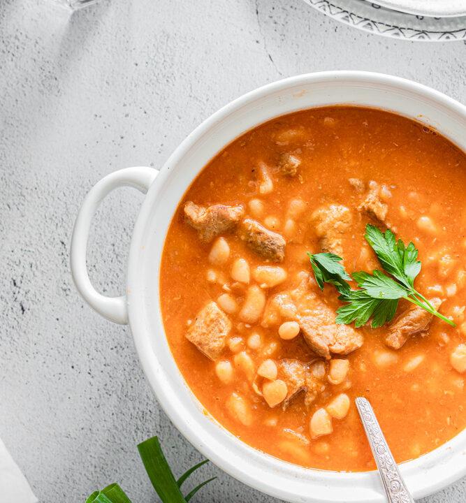 Fasolia white bean stew served in a white pot