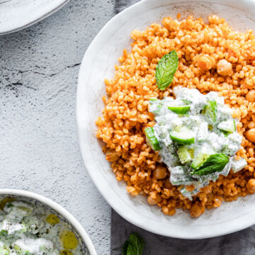 bulgur pilaf served with cucumber yogurt salad