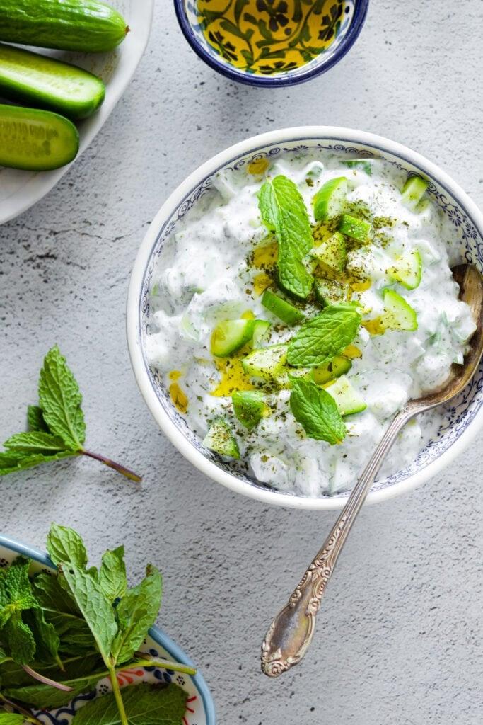 Jajik cucumber yogurt salad served in a bowl garnished with mint