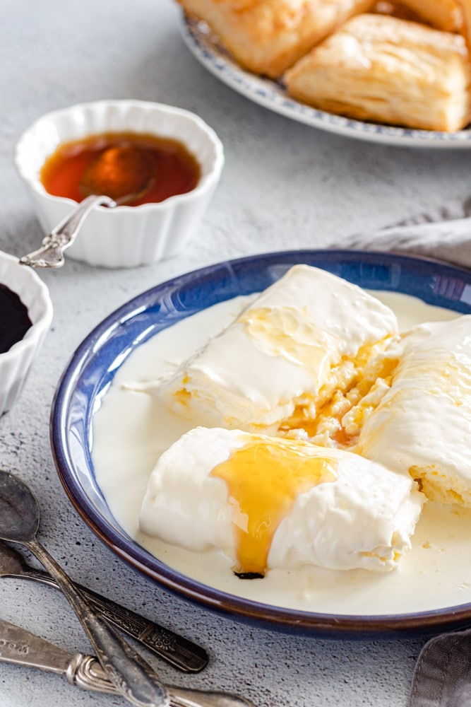 Geymar / Kaymak drizzled with honey served with puff pastry Kahi and date molasses