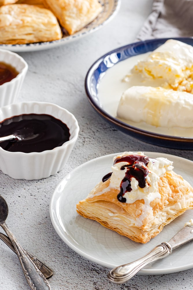 Kaymak / Geymar served on puff pastry kahi drizzled with date molasses