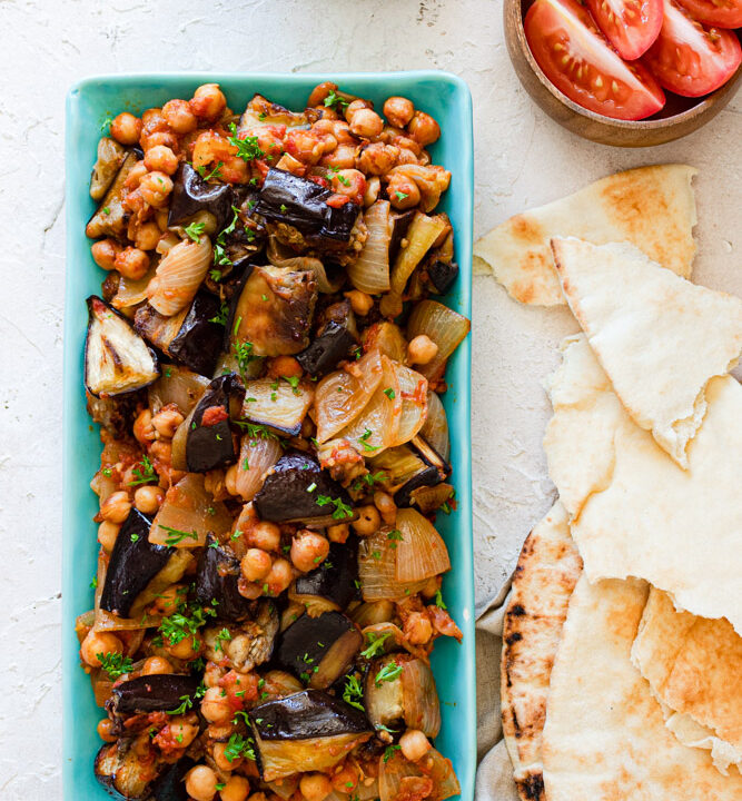 Vegan Lebanese Moussaka served in a dish with pita bread