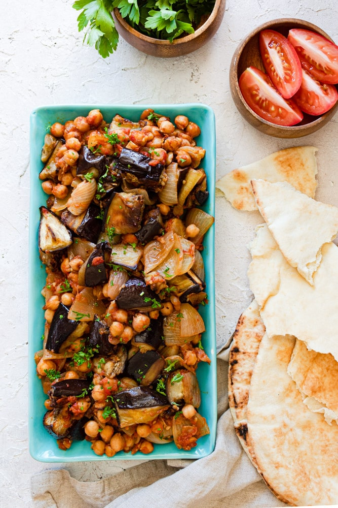 Lebanese moussaka served with pita bread on a blue plate