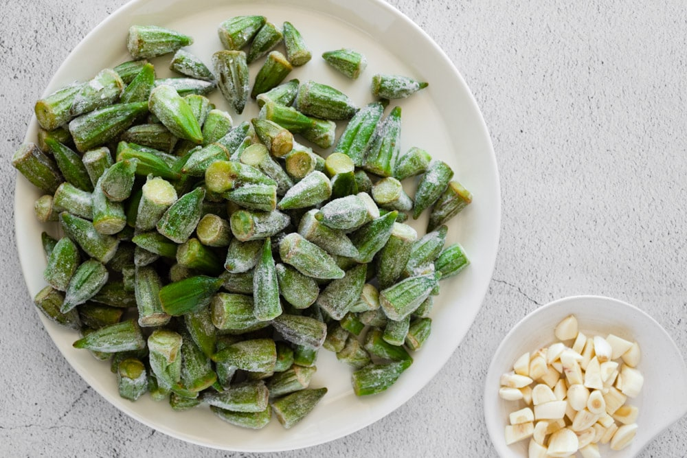 Frozen okra on a plate with garlic