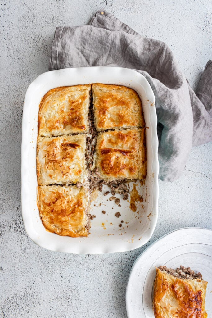 Egyptian goulash meat pie in a pan, cut into pieces
