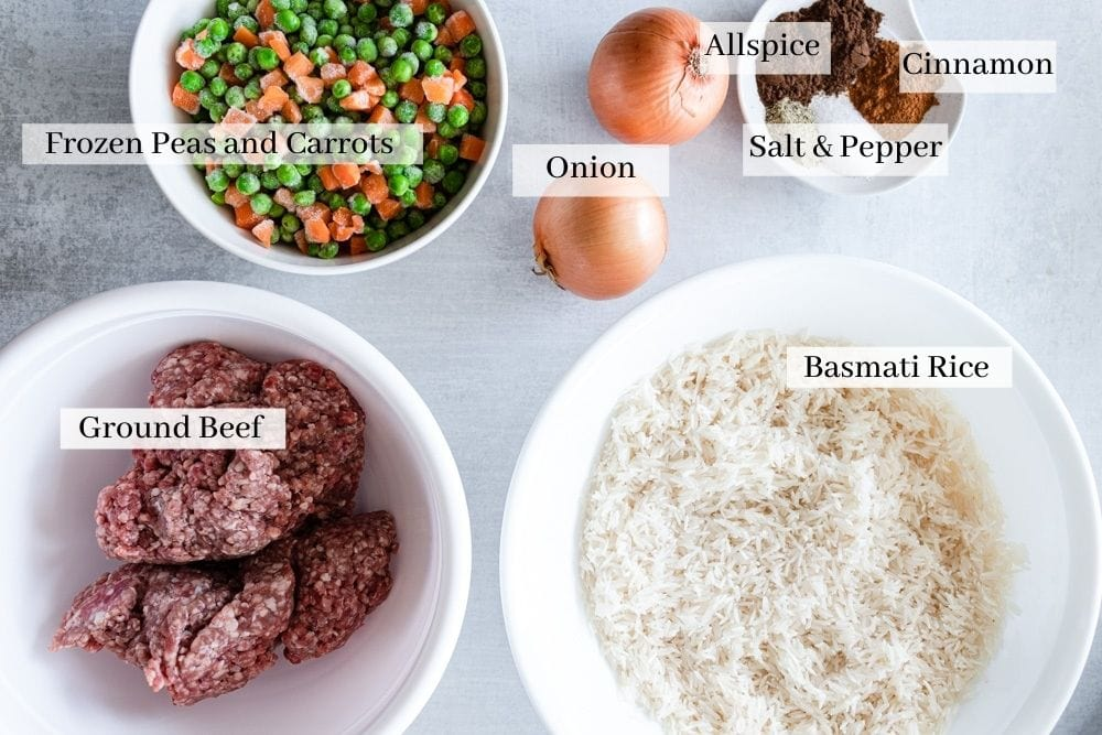 Ingredients needed for Hashweh rice which are frozen peas and carrots, onion, allspice, salt, pepper, cinnamon, rice, and ground beef