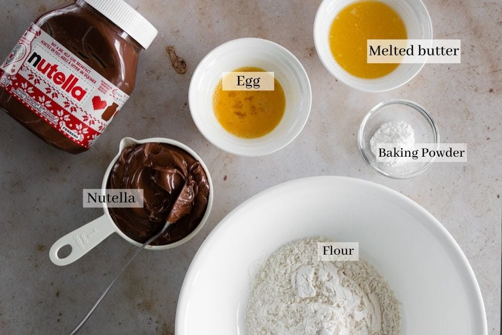 Ingredients for Nutella cookies, which are Nutella, egg, melted butter, baking powder and flour