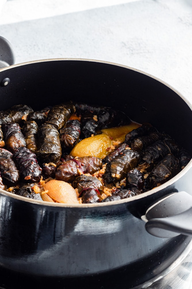 Iraqi dolma (which is stuffed vegetables) in a black pot