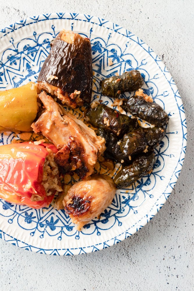 Iraqi dolma (which is stuffed vegetables) served in a blue patterned plate