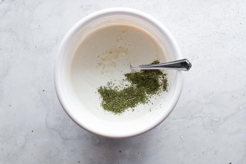 Yogurt, tahini and mint sauce in a white bowl