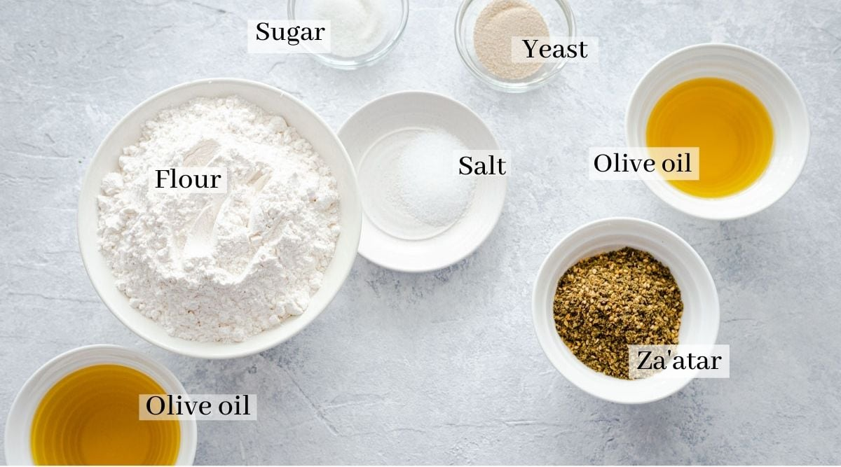 ingredients for manakish which are flour, olive oil, sugar, salt, yeast and za'atar