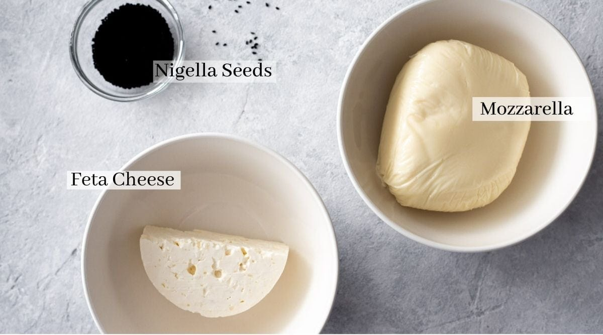 ingredients for cheese topping which are feta cheese, mozzarella cheese and nigella seeds