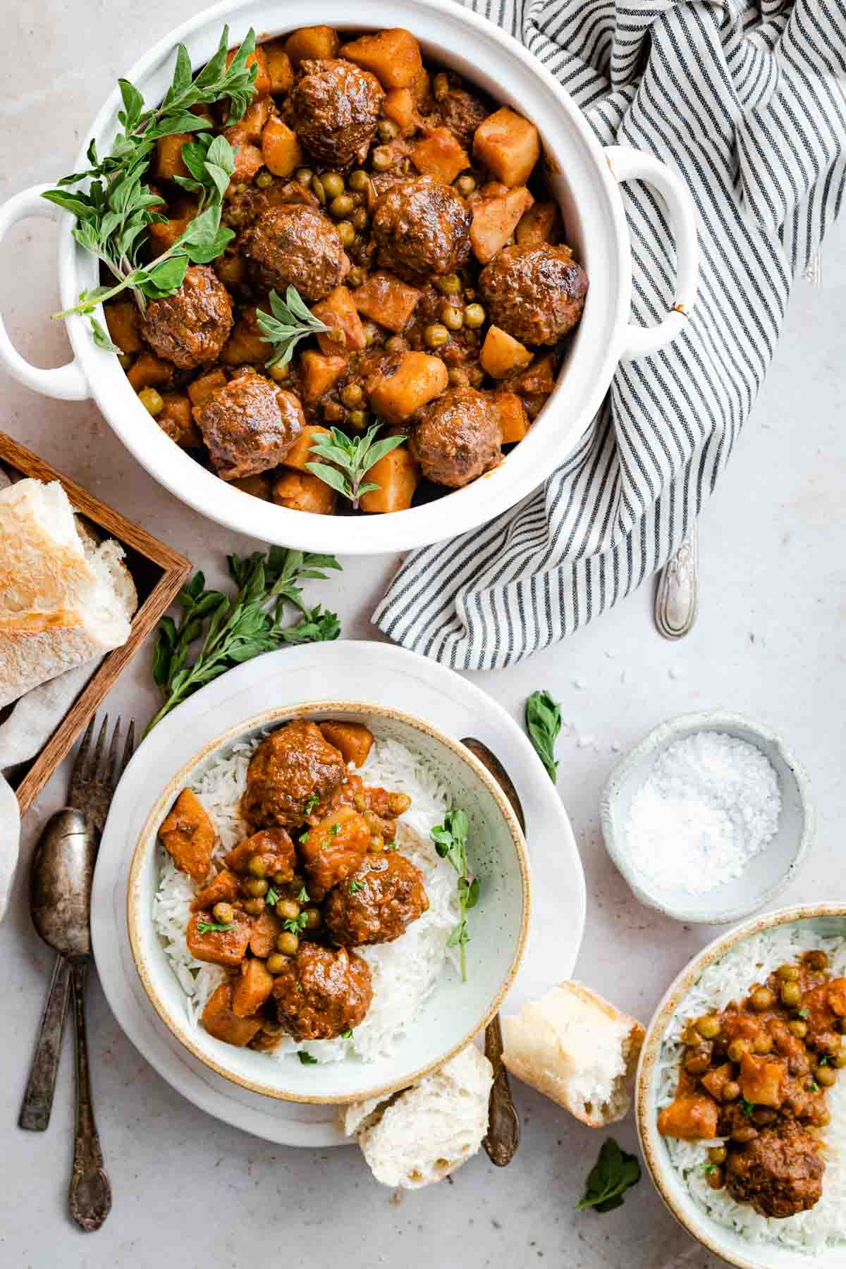 middle eastern meatball stew with peas and potato served with a side of bread