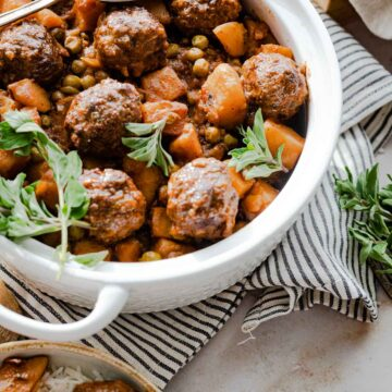 Meatball stew with peas and potato served in a pot