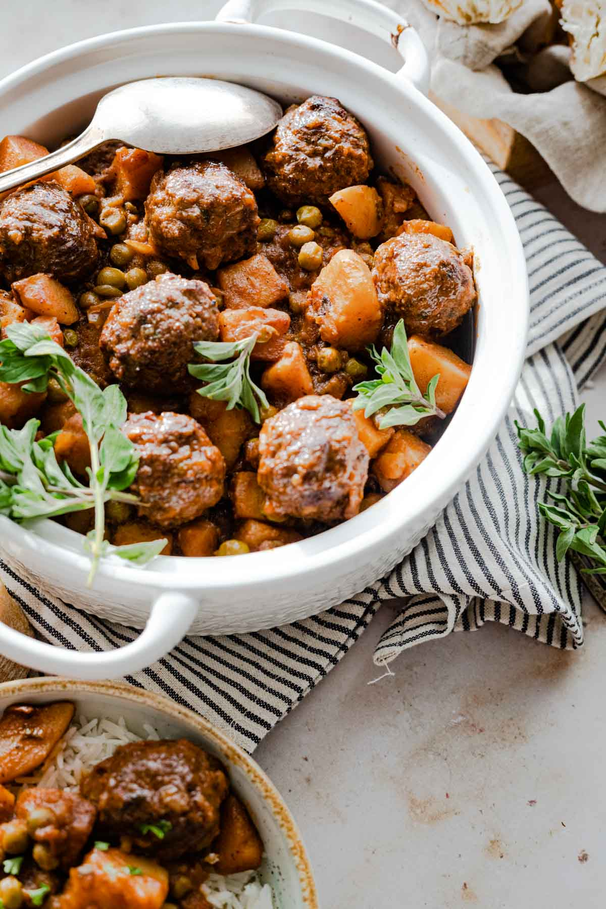 dawood basha Meatball stew with peas and potato served in a pot
