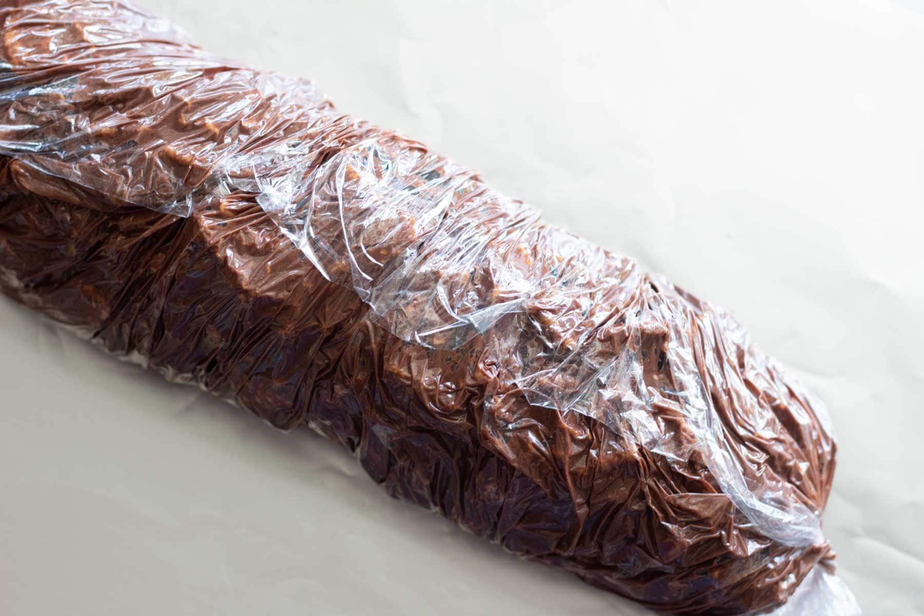lazy cake log wrapped in plastic wrap