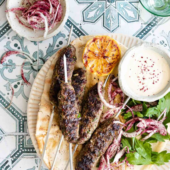 Kafta skewers served on pita bread with onions and parsley