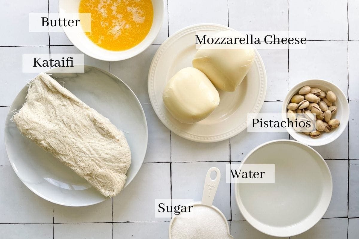 ingredients for kunafa which are kataifi dough, melted butter, mozzarella cheese, sugar, water, and pistachios