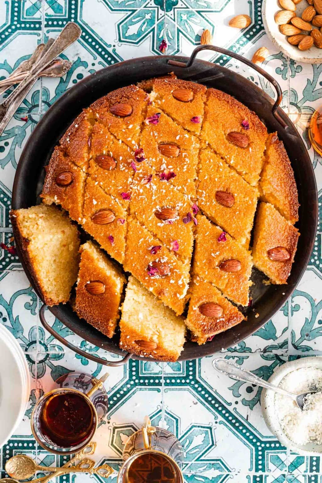 Semolina cake pieces displayed in a tray served with black tea.